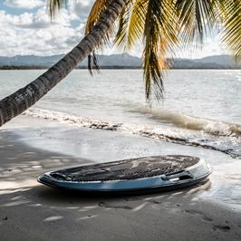 motorized surfboard on the beach